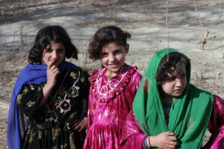 Three Afghan girls pose for the camera in the Khowst province of Afghanistan on December 1, 2004. during Operation Enduring Freedom. U.S. Marine Corps official photo by Corporal Justin L. Schaeffer. Courtesy of the National Archives and Records Administration.