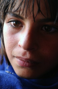 A close up of an Afghan girl from the Pashtun tribe in Kabul, Afghanistan. July 16, 2002. Courtesy of the National Archives and Records Administration.